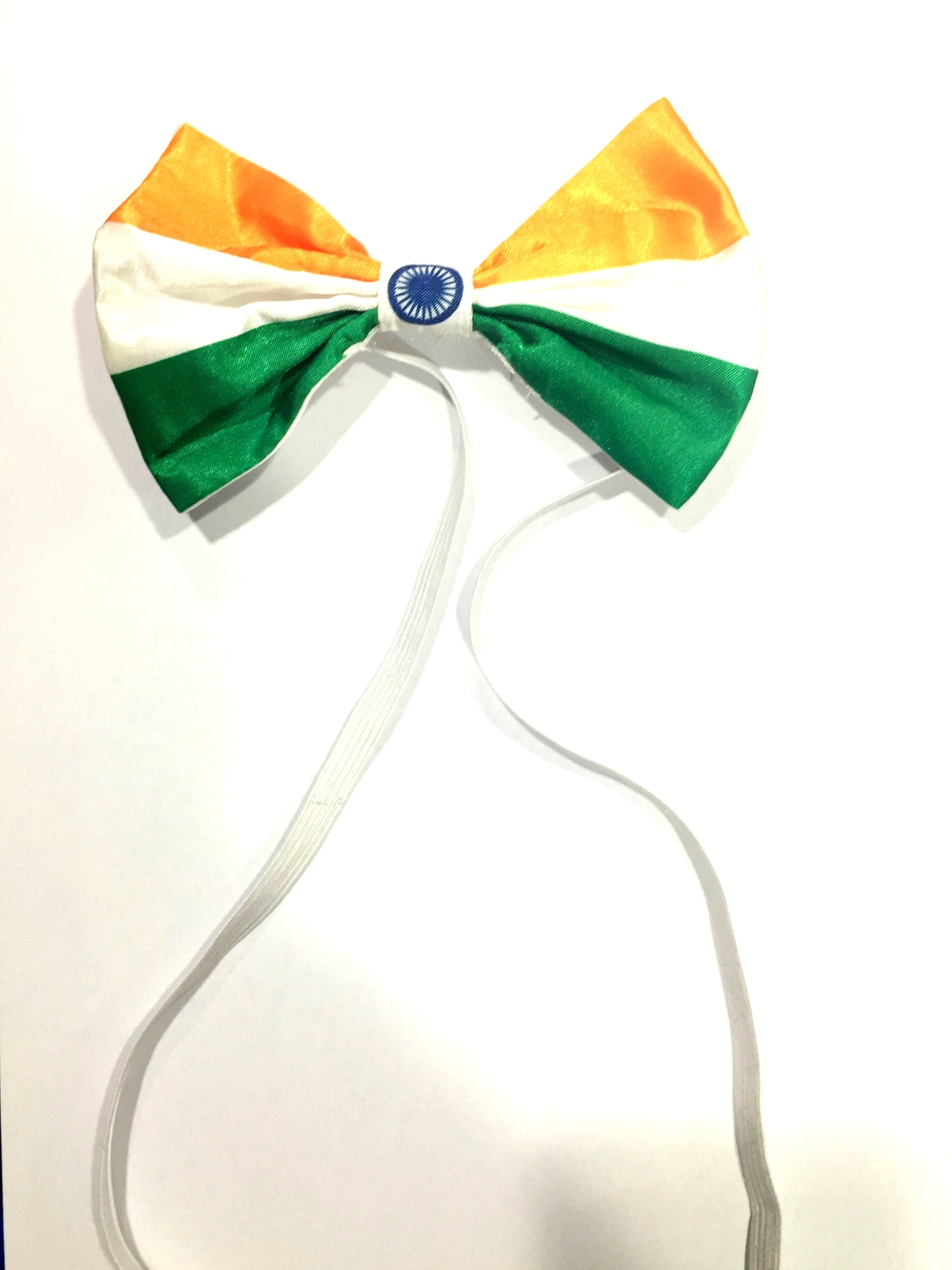 The Indian flag representing India. Available as a standard pre-tied bow tie only. Made in Britain. Made with % Polyester Satin. Dry clean only.
